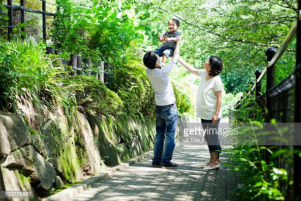 Parents and boy playing in a park