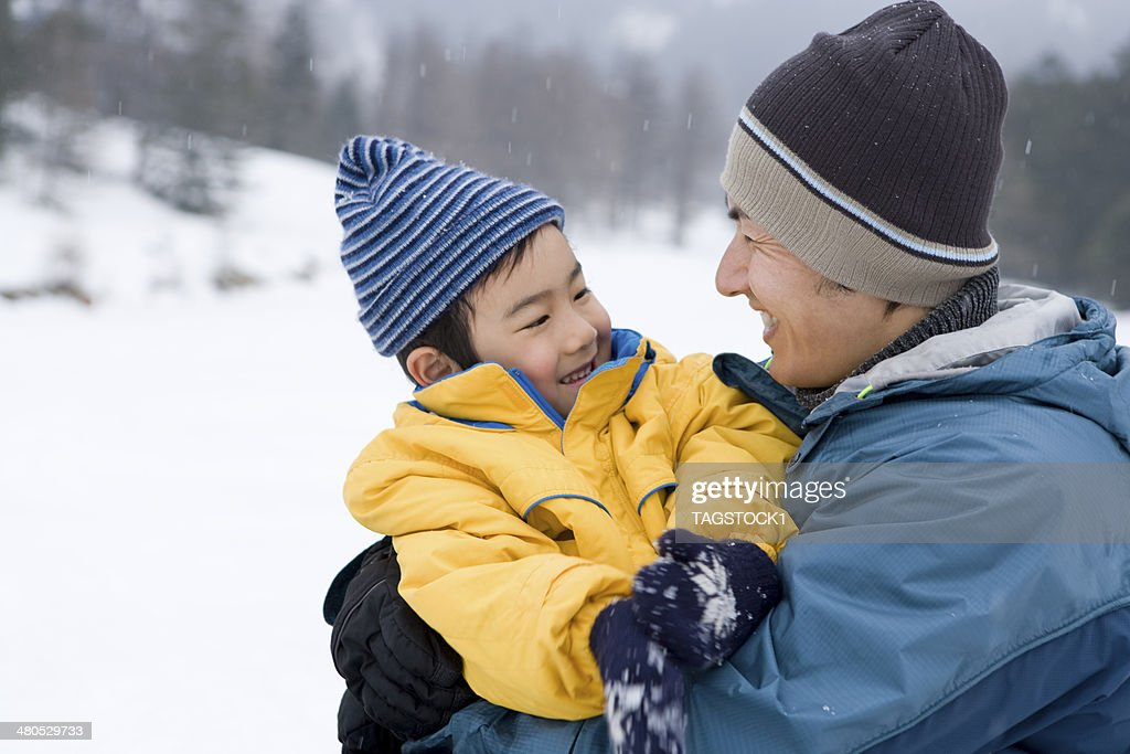 Parents and child in winter : Stock Photo