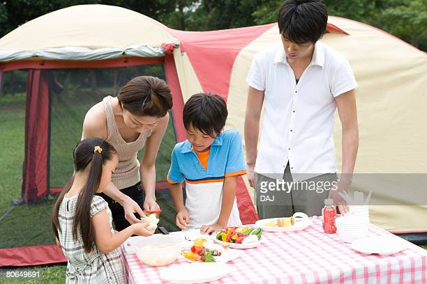 Parents and children cooking on a table, summer