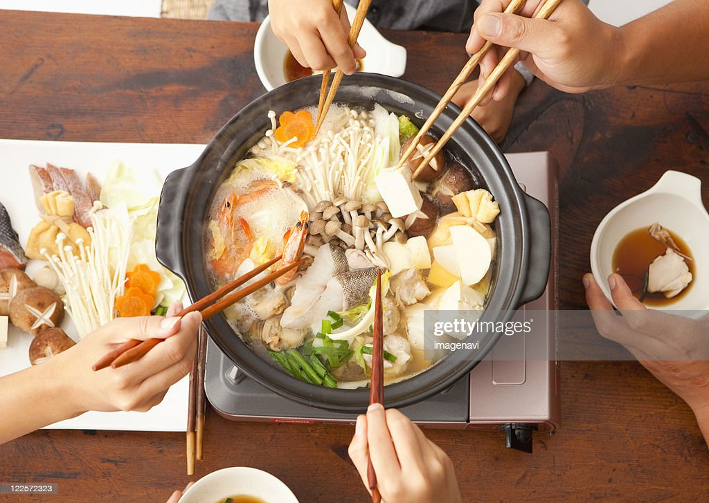 Parents and children eating Japanese nabe : Stock Photo