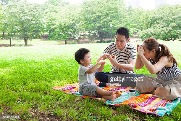 Parents and children enjoying a picnic in the park
