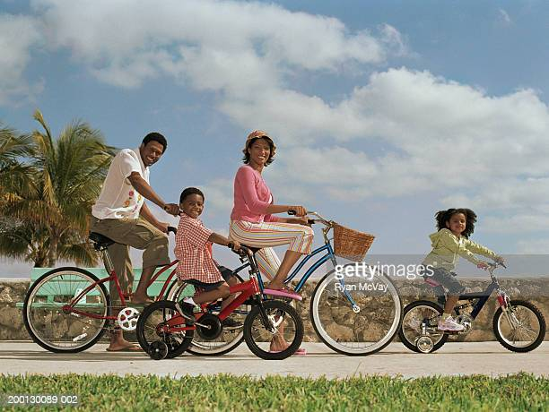 parents and children (4-6) riding bicycles, portrait - pedal pushers stock pictures, royalty-free photos & images