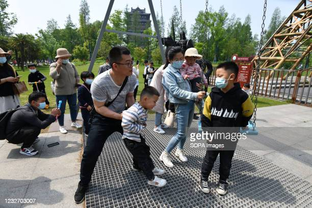 """Parents and children visit the Fuyang ecological park during the May Day holiday. At the beginning of 2021, the """"cliff like"""" decline of China's birth..."""
