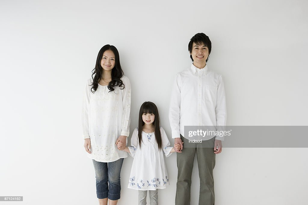 Parents and daughter holding hands, portrait : ストックフォト