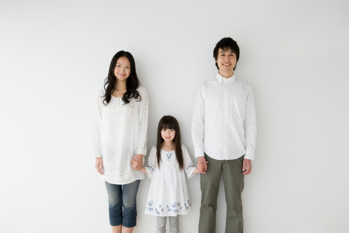 Parents and daughter holding hands, portrait - gettyimageskorea