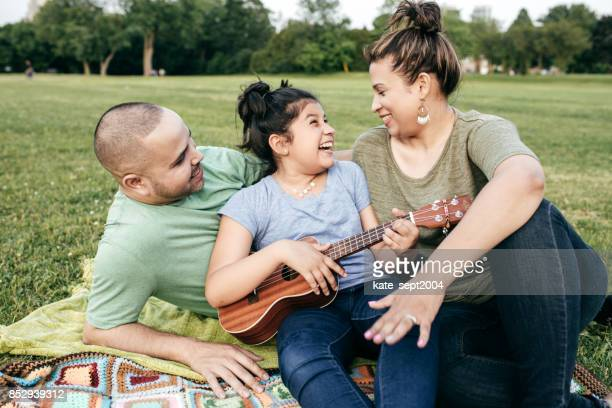 Parents and daughter on picnic