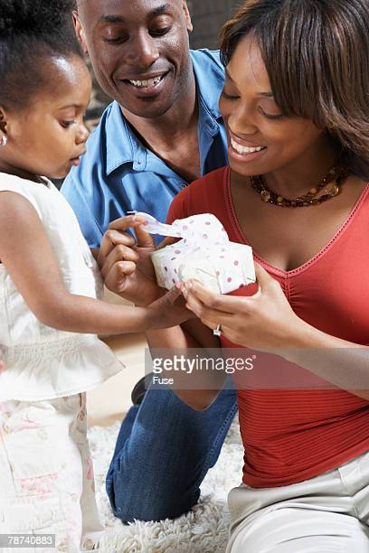 Parents and Daughter with Present