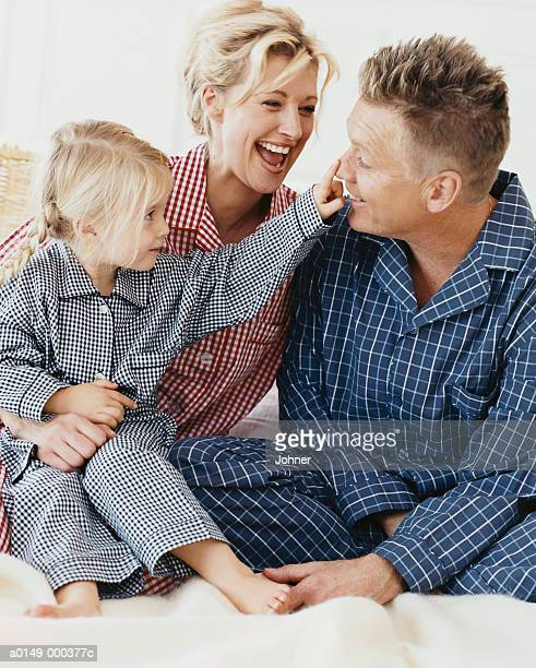 Parents and Girl in Pajamas