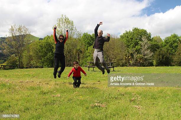 Parents and little son jumping