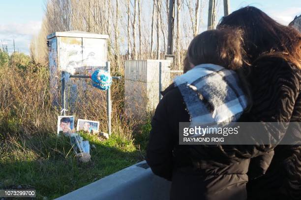 Parents and relatives mourn on December 14 during a march in memory of victims dead one year before in a collision between a train and a school bus...