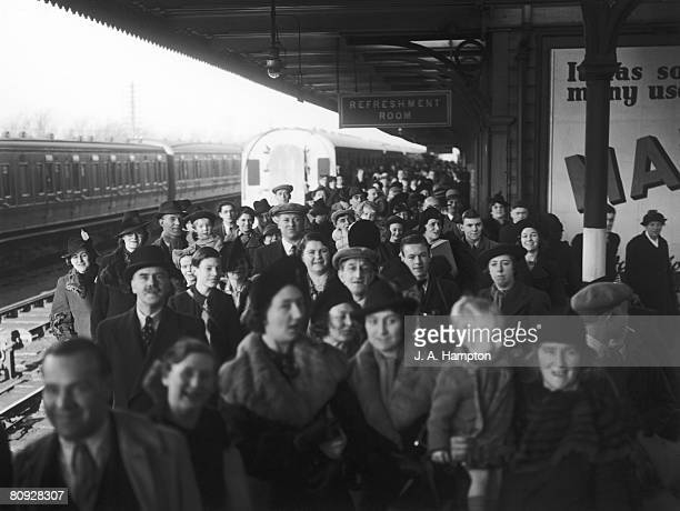 Parents and relatives of evacuees waiting for the arrival of the London Midland and Scottish Railway's Evacuation Special at Northampton railway...