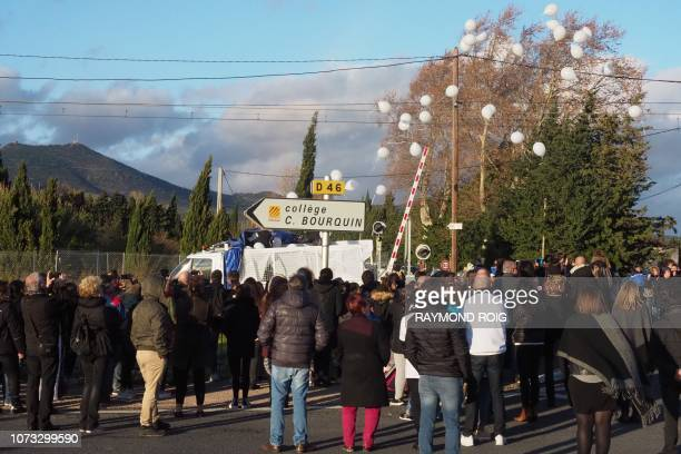 Parents and relatives release balloons during a march held on December 14 in memory of victims dead one year before in a collision between a train...