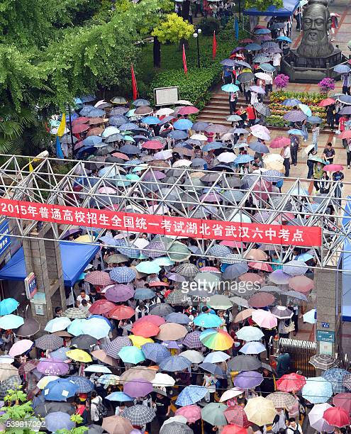 Parents and reletives are waiting for to the candidates taking an exam for the national college entrance at a school in Wuhan Hubei province east...