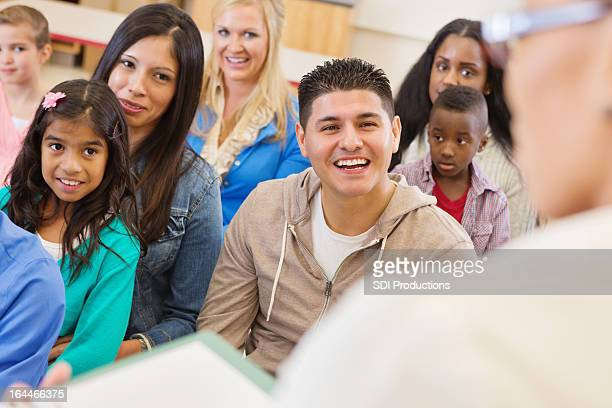 Parents and students attending school assembly or orientation