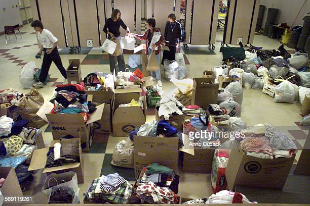 Parents and students from Lang Ranch Elementary School in Thousand Oaks sort clothing that families donated for the fire victims from Sundays...