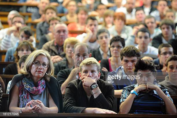 Parents and students wait to register for internship in an amphitheater at the Agricultural College in Rouillon western France on September 4 2012...