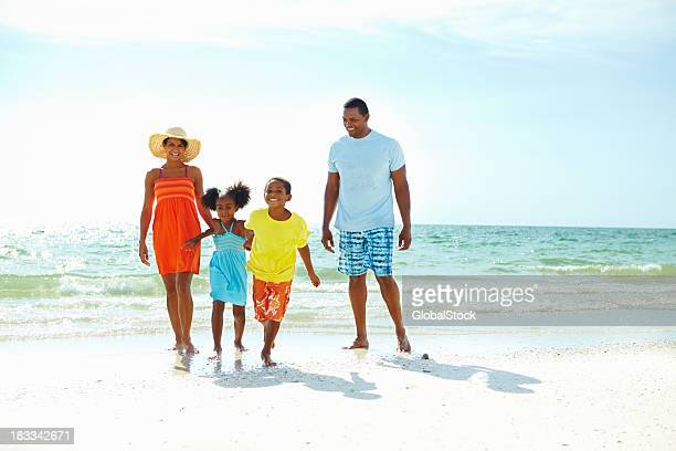 Parents and their two children on the beach