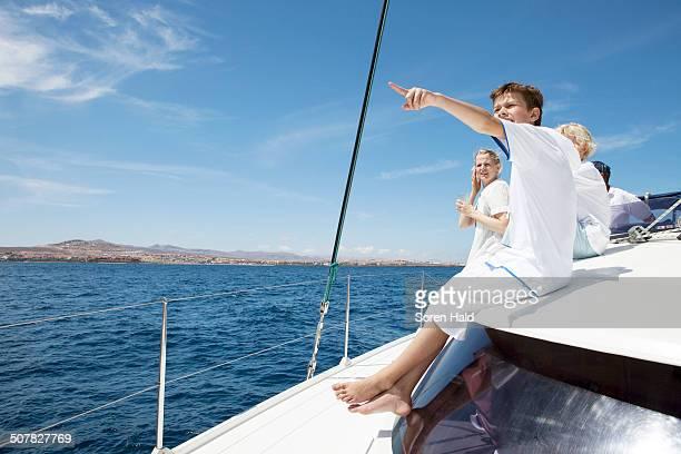Parents and three sons sailing on catamaran near Fuerteventura, Spain
