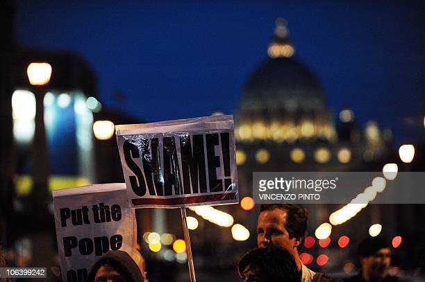 Parents and victims of priest abuse hold banners reading 'Shame ' and ' Put the pope on trial ' during a demonstration in Rome in front of the...