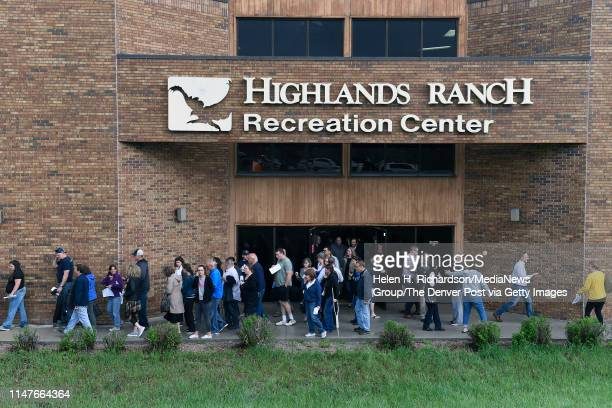 Parents are guided from the Highlands Ranch Recreation Center at Northridge to pick up their kids after a shooting at the nearby STEM School on May 7...