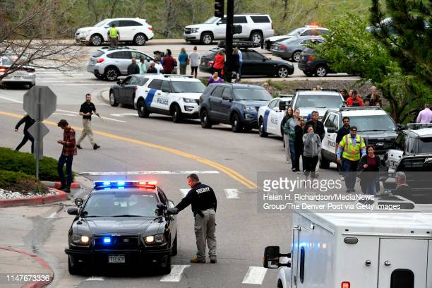 Parents arrive amidst lots of emergency vehicles at the Highlands Ranch Recreation Center at Northridge to pick up their children after a shooting at...