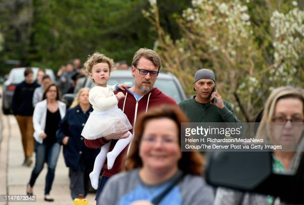 Parents arrive at the Highlands Ranch Recreation Center at Northridge to pick up their children after a shooting at the STEM school on May 7, 2019 in...