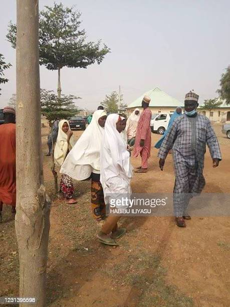 Parents arrive at the school compound in search of children kidnapped by bandits, in Jangede, Zamfara State in northwest Nigeria, on February 26,...