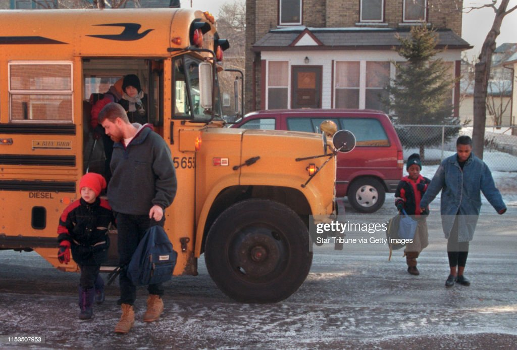Parents arrived at Holland Elementary School Monday morning with their children. Gary Johnson and his son, Nicholas arrived by bus while Ava Reed and her son Carl Conner, right, came on foot : News Photo