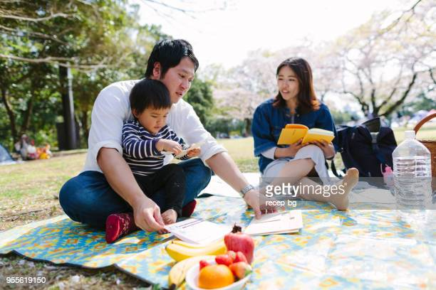 parents assembling toy parts - hanami stock pictures, royalty-free photos & images