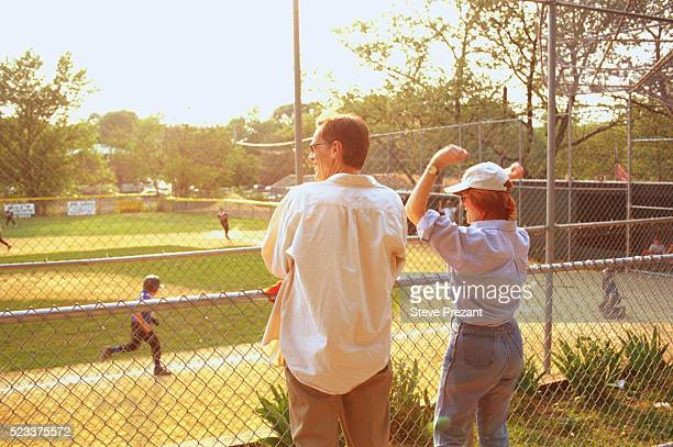 Parents Cheering at Little League Game