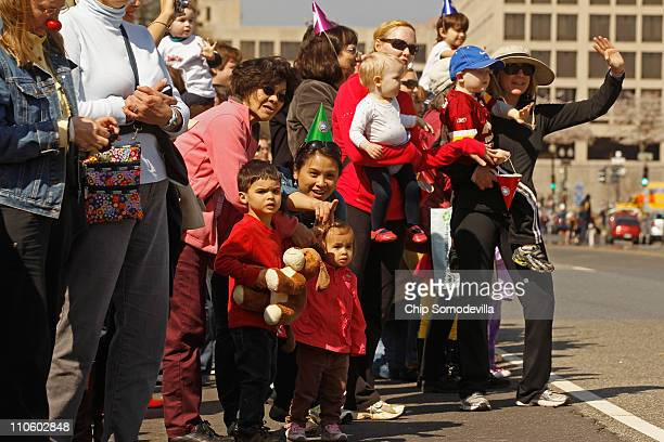 Parents children and circus fans line up along 3rd Street NW to watch the Ringling Bros Barnum and Bailey's annual Pachyderm Parade on the National...