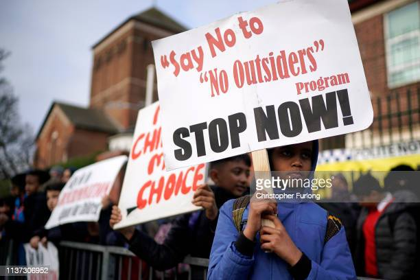 Parents children and protestors demonstrate against the 'No Outsiders' programme which teaches children about LGBT rights at Parkfield Community...