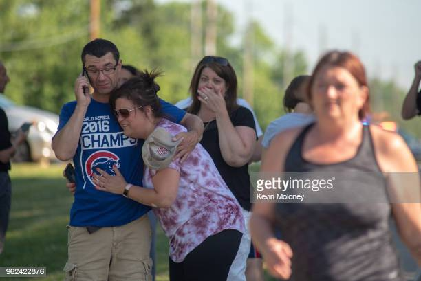 Parents comfort each other as they wait outside Noblesville West Middle School after a shooting at the school on May 25 2018 in Noblesville Indiana...