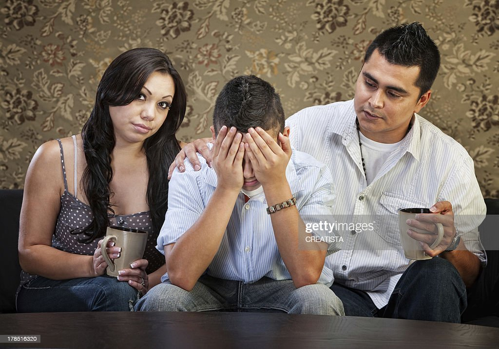 Parents Comforting Their Son : Stock Photo