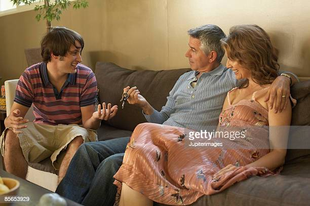 Parents conversing with son