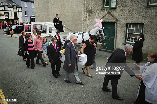 Parents Coral Jones and Paul Jones and their son Harley Jones follow the coffin of of their murdered daughter April Jones as they arrive at St...