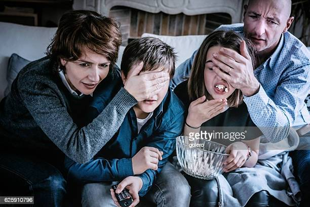 parents covering kids eyes for not watching adult tv content