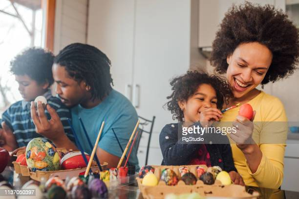 parents decorating eggs with children - easter photos stock pictures, royalty-free photos & images