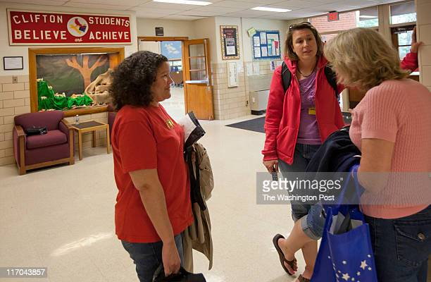Parents, from left, Anne Beaudreau, Ann Jones and Lisa Desman socialize at Clifton Elementary School will close at the end of this school year...