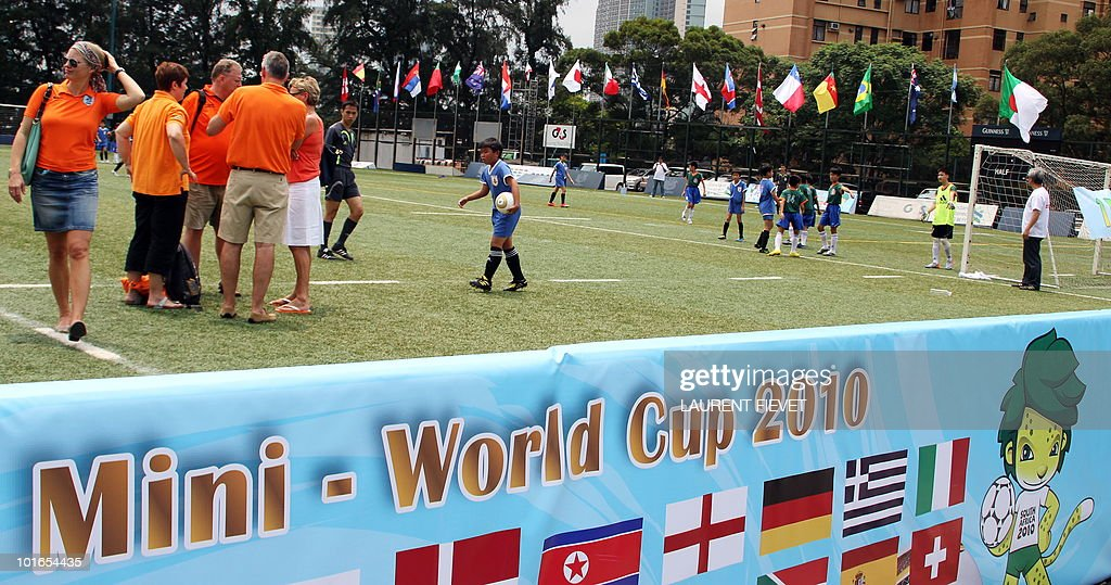 Parents (L) from the Netherland watch young football players taking part in the Mini World Cup 2010 in Hong Kong on June 6, 2010. The South Africa 2010 World Cup will start on June 11.