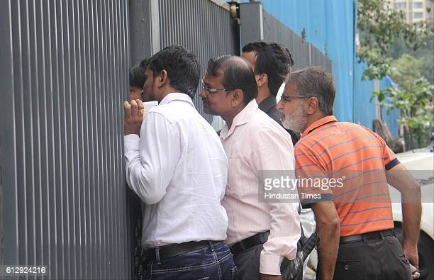 Parents gather outside Delta IT Park building where the call centre was situated during police inquiry as police personnel arrested the accused...