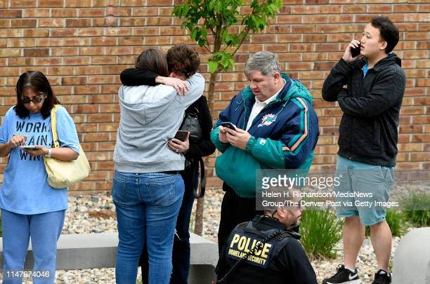 Parents gather outside of the Highlands Ranch Recreation Center at Northridge as they wait to pick up her children after a shooting at the STEM...