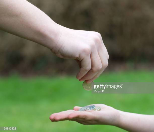 Parents hand giving Pocket money to child