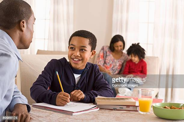 parents helping with home work - afro caribbean ethnicity stock pictures, royalty-free photos & images