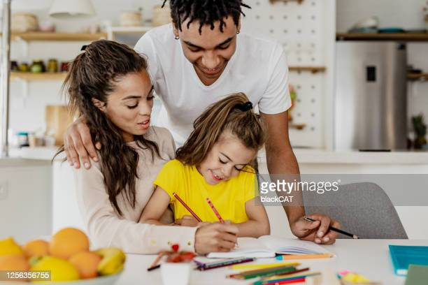 parents helping with homework - learning disability stock pictures, royalty-free photos & images