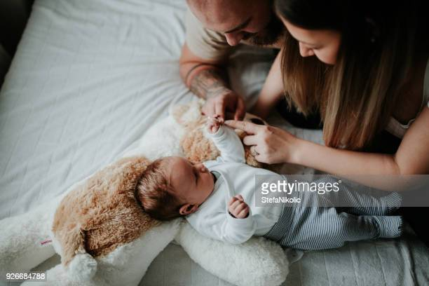 parents home from hospital with newborn baby - parent stock pictures, royalty-free photos & images