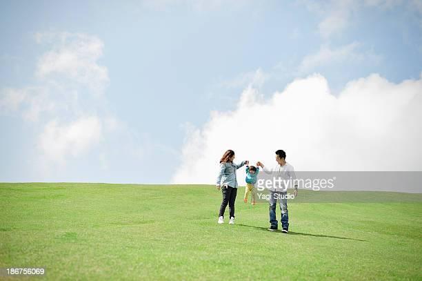 Parents lifting daughter mid air