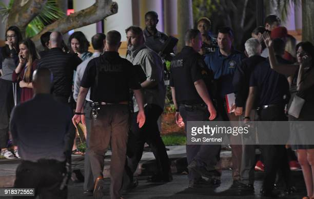 Parents meet at the Fort Lauderdale Marriott Coral Springs Hotel to pick up their children following a mass shooting at nearby Marjory Stoneman...