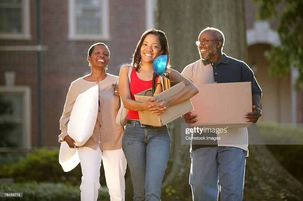 Parents moving college student : Stock Photo
