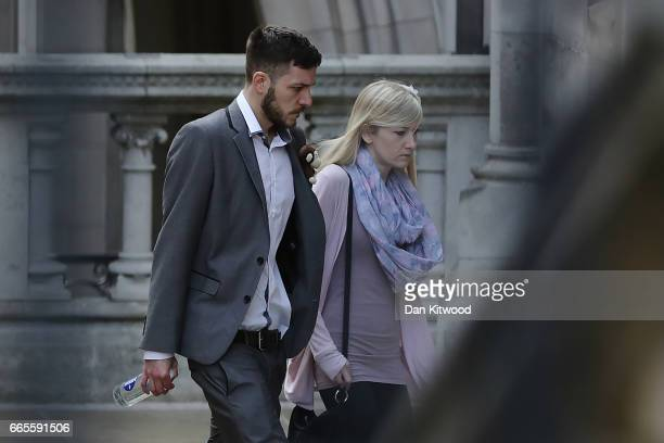 Parents of Charlie Gard Chris Gard and Connie Yates walk through the grounds of the Royal Courts of Justice on April 7 2017 in London United Kingdom...